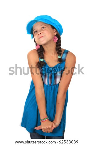 Pretty ten year old adolescent multi ethnic girl with pigtails and colorful blue hat looking bashful or wishful on a white background
