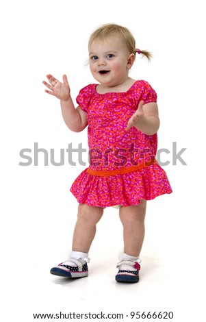 pretty toddler girl clapping her hands