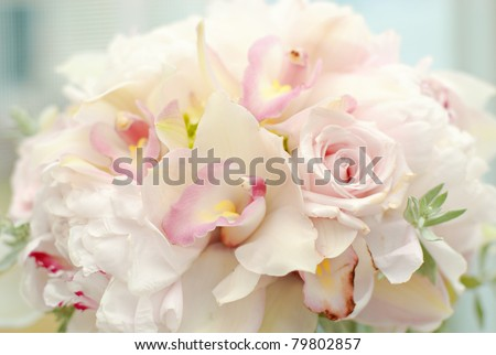 pretty wedding bouquet of roses orchids and greenery