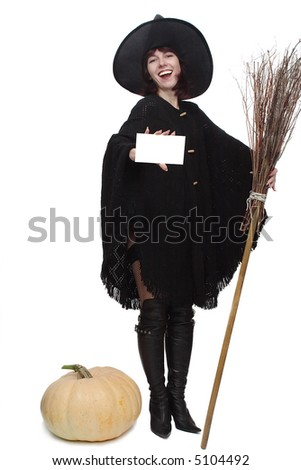 Pretty witch with a broom, holding a card to advertise something, with a large pumpkin at her feet. Focus on the card