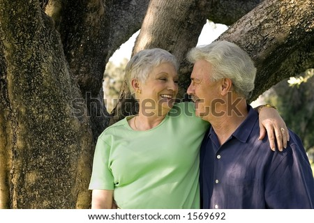 pretty woman and handsome man make a cute older couple in love.