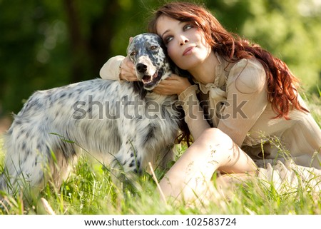 pretty woman and her dog enjoy in  summer day in grass