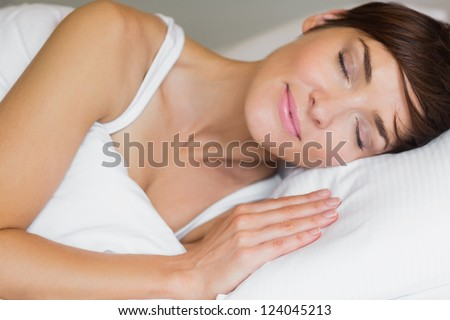 Pretty woman asleep in bed