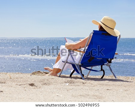 Pretty woman at the beach in summer portrait