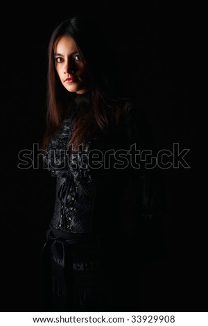 Pretty woman coming out of the shadows.