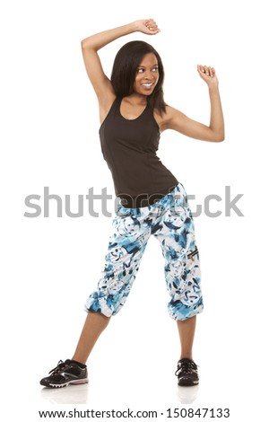 pretty woman exercisig zumba on white isolated background