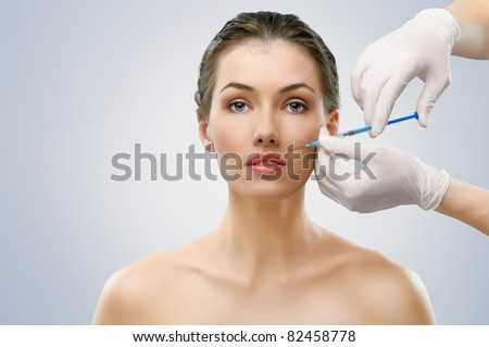 pretty woman getting an injection - stock photo