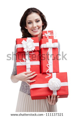 Pretty woman hands a number of gift boxes, isolated on white