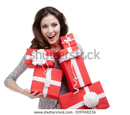 Pretty woman hands a number of gift boxes with white ribbons, isolated on white