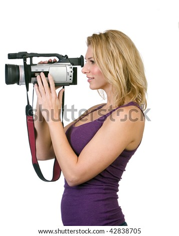 Pretty woman holding camcorder. Side image profile shot.