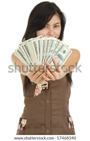 pretty woman holding lots of 100 dollar bills in her hand, isolated on white background with a shallow depth of field, focussed on the dollar bills