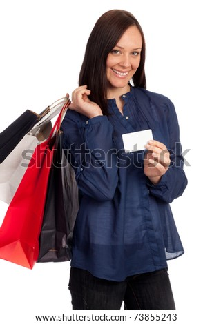 Pretty woman holding shopping bags and credit card on white background