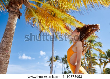 Pretty woman in a yellow swimsuit nature vacation travel vacation leisure lifestyle Relax sun tan bikini tropics #1410675053