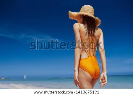 Pretty woman in a yellow swimsuit nature vacation travel vacation leisure lifestyle Relax sun tan bikini tropics #1410675191