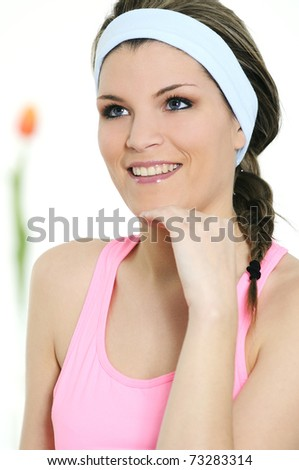 pretty woman in active clothed is smiling