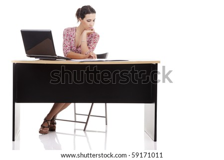 pretty woman in desk with computer, isolated on white background. Studio shot.