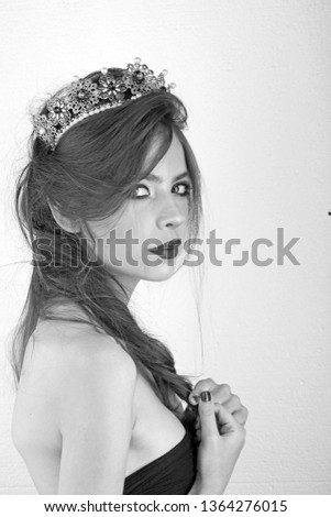 Pretty woman in elegant style. Pretty woman in crown has fashionable makeup.
