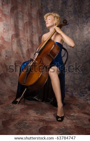 Pretty woman in evening dress playing cello