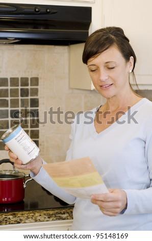 Pretty woman in kitchen preparing dinner