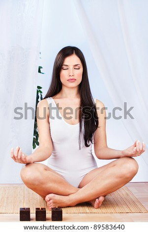 Pretty woman in lotus pose at meditation