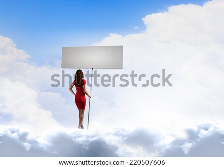 Pretty woman in red dress with white blank banner