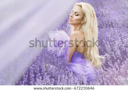 Pretty woman in summer day in lavender field. Lavender field concept.