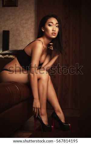 Pretty woman in underwear on the couch #567814195