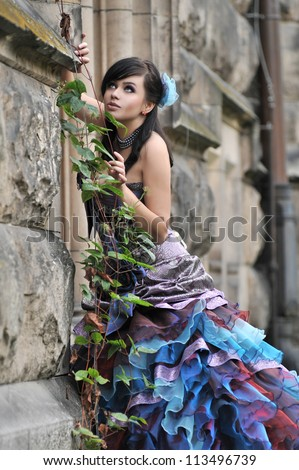 Pretty woman in violet wedding dress