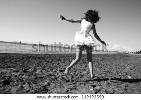 Pretty woman in white dress on beach in Limassol, Cyprus.