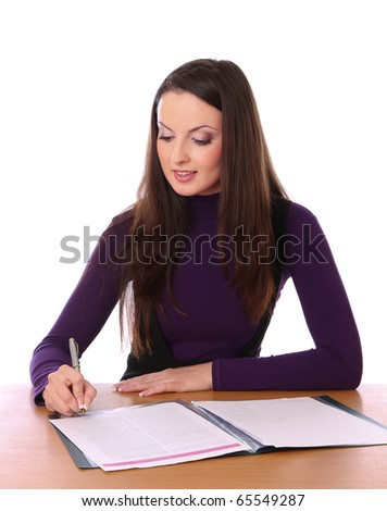 pretty woman is signs the document. Isolated at white background