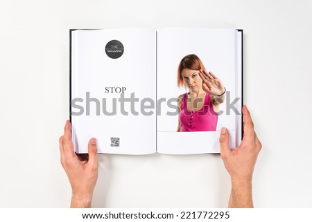 Pretty woman making stop sign printed on book #221772295