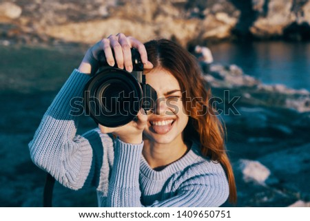 Pretty woman on nature with a camera lifestyle photography portrait portrait picture