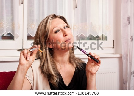 Pretty woman opts for an electronic cigarette and destroys the normal