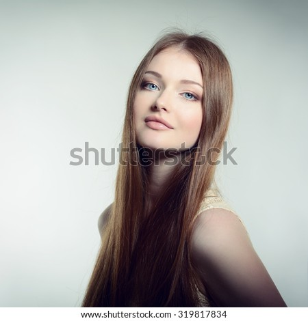 Pretty woman. Portrait of young attractive woman. Image toned. #319817834