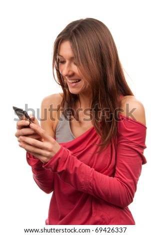 Pretty woman reading, typing and sending SMS text message on mobile cellphone smiling and laughing isolated on a white background