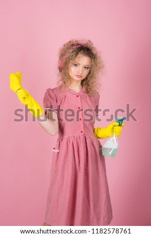 Pretty woman ready to do housework. Housework helper in rubber gloves with cloth and sprayer bottle. Extreme clean. #1182578761