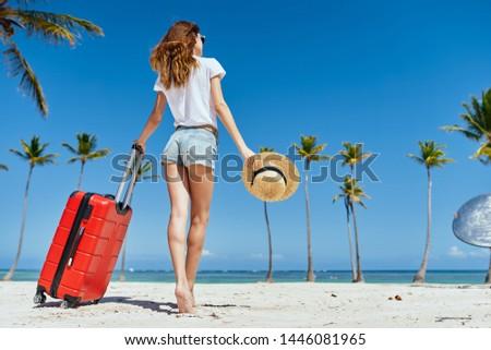 Pretty woman red suitcase for travel destination destination exotic