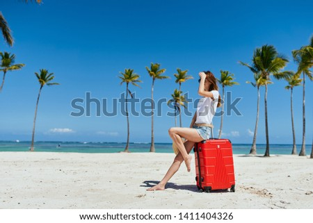 Pretty woman red suitcase travel beach sea vacation vacation tropics