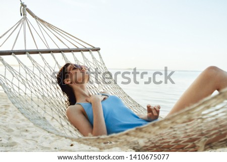 Pretty woman resting in a hammock beach trip vacation nature vacation vacation relaxation Summer sun #1410675077