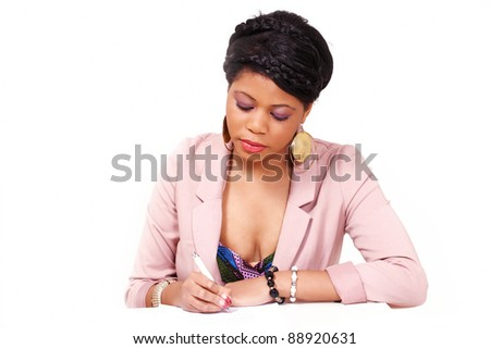 Pretty woman signing contract or filling a form with concentration