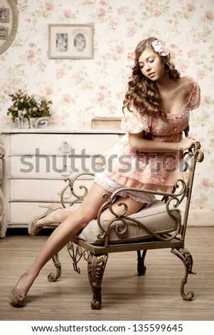 Pretty woman sitting in a room with a vintage interior