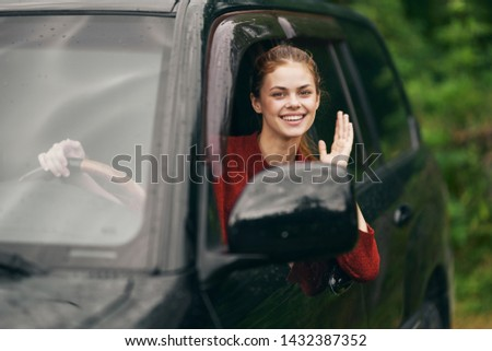 Pretty woman sitting in the car interior countryside nature summer traffic transportation #1432387352