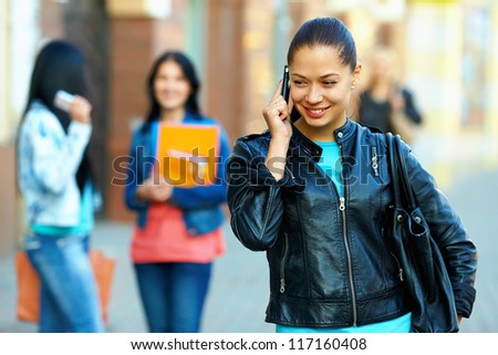 pretty woman talking on the mobile phone, outdoor on the street