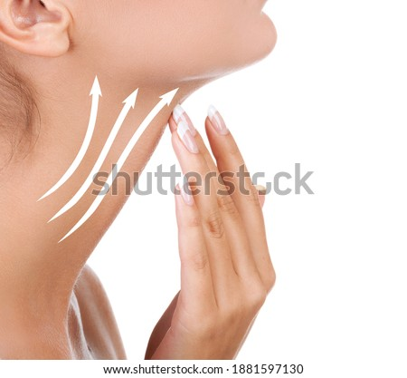 Pretty woman touching her neck, isolated on white background. Anti-aging concept Foto stock ©