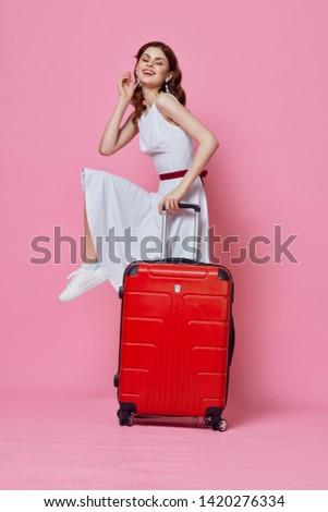 Pretty woman white dress red suitcase travel destination destination lifestyle