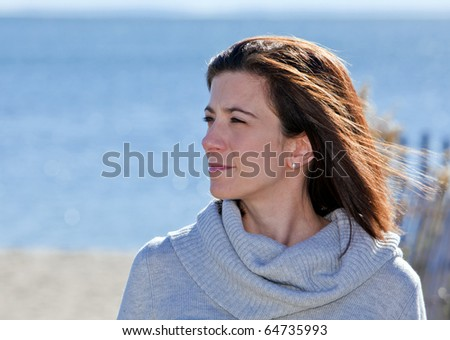 Pretty woman with confident smile portrait at the beach - stock photo