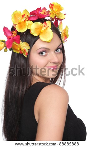 Pretty woman with flowers on head. Isolated on a white background