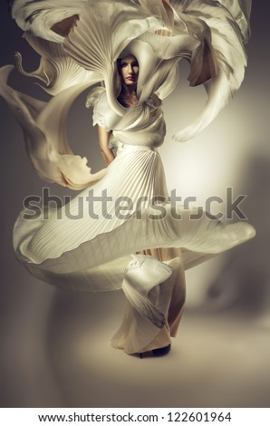 pretty woman with long flying dress