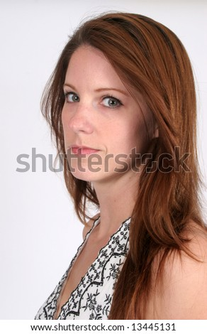 Pretty woman with long hair and serious look for the viewer #13445131