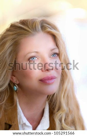 Pretty Woman with Long Hair looking into the light with shadow effect